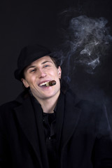 Man in black hat smoke cigar and smile