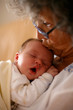 Grandma kissing baby