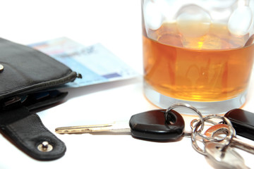 wallet whiskey car keys and euro cash