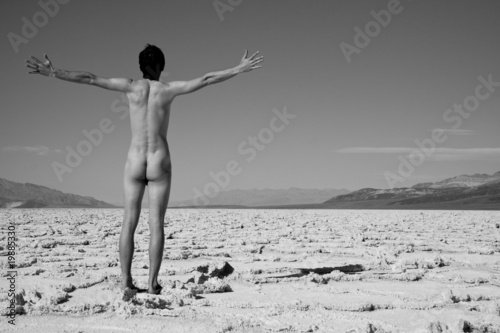 Naked man walking in Death Valley