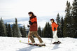 Couple Skiing on Mountain Slope