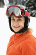 Portrait of Smiling Female Skier