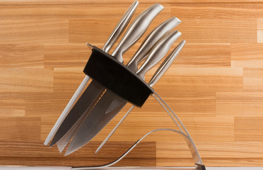 series of images of kitchen ware. Knife set