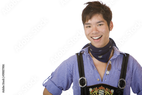 Young man in Bavarian Oktoberfest leather trousers (Lederhose)