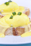 Eggs Benedict on toast with creamy hollandaise sauce.