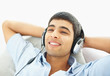 Portrait of a relaxed young guy enjoying music with copyspace