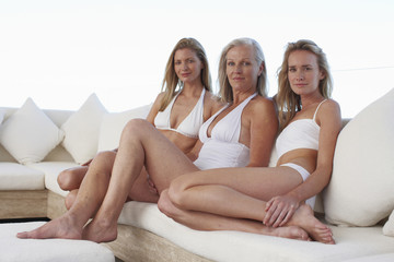 Three women in bikinis