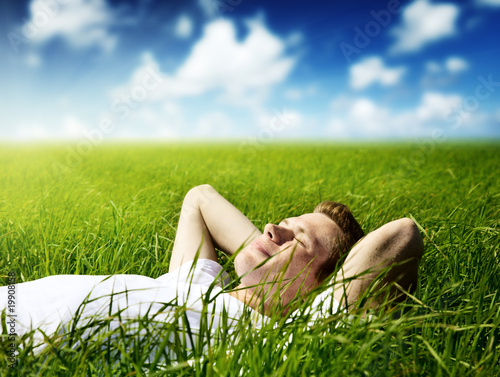 young man in grass