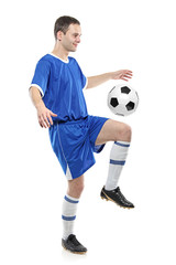 Soccer player with a ball isolated against white