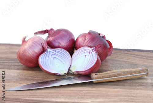 Spanish onions and knife isolated on white background.
