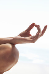 Female hand in yoga pose