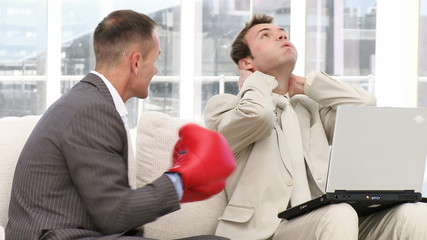 Mature businessman punching his colleague
