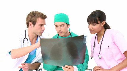 Multi-ethnic medical team examining an x-ray