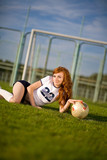 healthy beautiful girl with freckles on soccer field poster