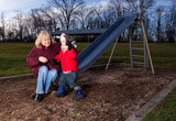 A Grandmother with her Grandson having fun at outdoor playground poster