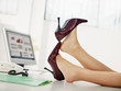 business woman taking off shoes