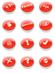 set of red buttons with a caution sign
