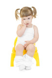 Little curious girl on chamberpot isolated