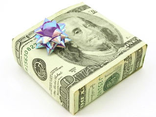 American 100 dollar bill wrapped around gift, isolated