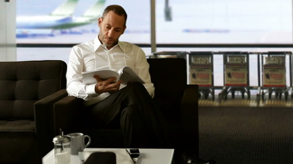 Businessman at airportlounge