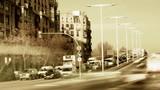 daytime timelapse of a street scene in barcelona poster