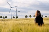 Woman in the barley with windmills