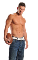Muscular man holding a football