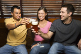 Three Friends Toasting With Beers poster