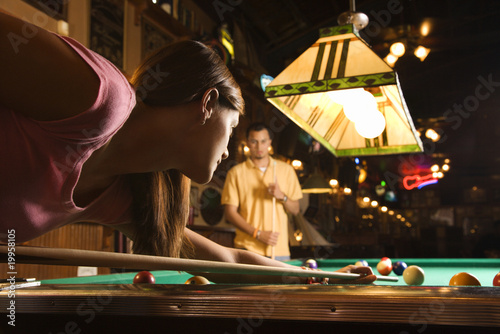 Young Woman Shooting Pool