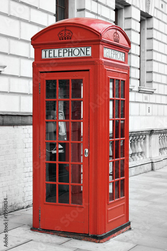 Red telephone booth in London, England © kmiragaya