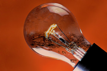 light bulb, Orange Background Clean Energy