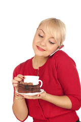 young blond woman holding a phone and cap of coffee