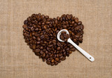 Coffee beans heart, white spoon on hessian