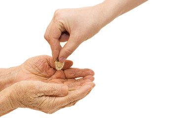 Young and old hand with a coin