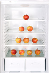 Pyramid of apples in the refrigerator