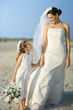 Bride and Flower Girl on Beach