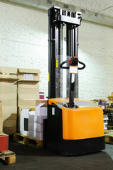 warehouse forklift stacker with boxes