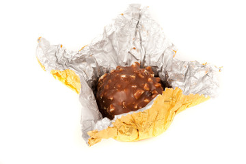 Delicious candy in golden foil