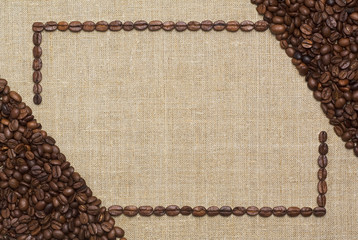 art coffee frame made of fried coffee beans on grunge canvas