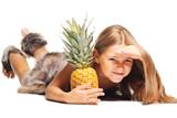 little girl dressed as prehistoric man taking pineapple poster