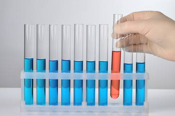 Hand with test tube
