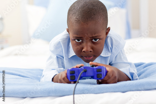 Happy little boy playing video game