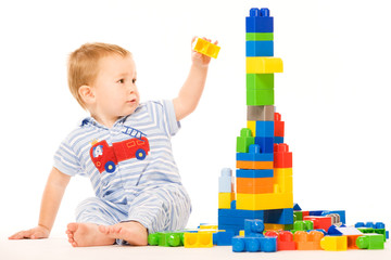 Little boy builds building