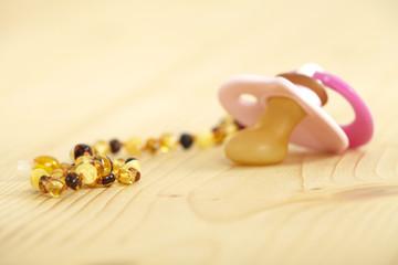 bernsteinkette und schnuller