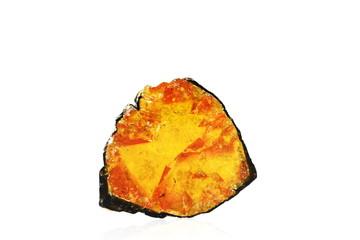 A rare orange polished tourmaline crystal slice