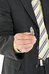Businessman giving you a pen
