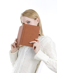 blond hair young woman covering face book