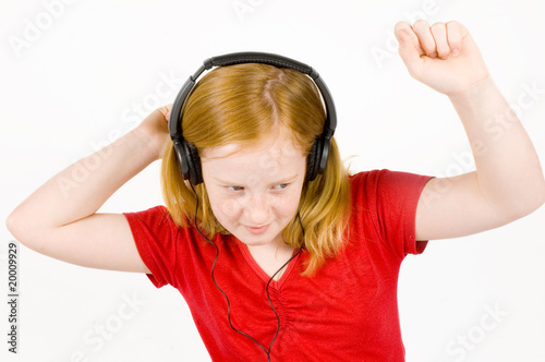 girl listening to music and dancing