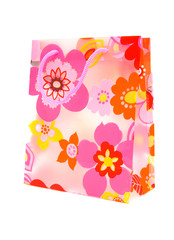 Plastic shopping bag with floral motif over white background