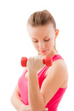 Young fit girl with dumbbells